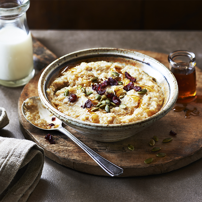 Quinoa Porridge with Gingered Maple Syrup and Pumpkin Cranberry Topping